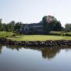 A view of a green with water coming into play at Virginia Oaks Golf Club