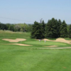 A view of a green protected by bunkers at Villa Olivia Country Club