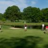 A sunny day view of a green at Big Met Golf Course