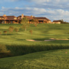 A view of the 1st green with clubhouse in background at Wildhorse Golf Club of Robson Ranch