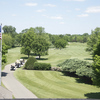 A view from the clubhouse with cart path on the left at Oakhurst Country Club